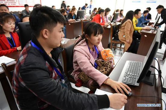 Residents attend an e-commerce training at a skill training center of a settlement for poverty relief relocation in Sansui County, southwest China's Guizhou Province, April 11, 2019. Since January, households have, one after another, moved into a settlement for poverty relief relocation in Sansui County. Many service facilities, including poverty alleviation workshop, health center, nursery and skill training center, are accessible to residents in the settlement. (Xinhua/Yang Wenbin)