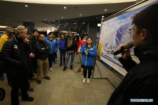 Photo taken on April 10, 2019 shows representatives from major world news agencies in the Genting Snow Park during a venue tour prior to the Beijing 2022 Olympic and Paralympic Winter Games World Agnecy Meeting in Beijing, capital of China. Representatives from major world news agencies are visiting Beijing for a first look at some of the facilities to be used at the 2022 Winter Olympic Games. (Xinhua/Xu Zijian)