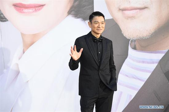 Actor Andy Lau poses on the red carpet during the 38th Hong Kong Film Awards in Hong Kong, south China, April 14, 2019. (Xinhua/Lui Siu Wai)
