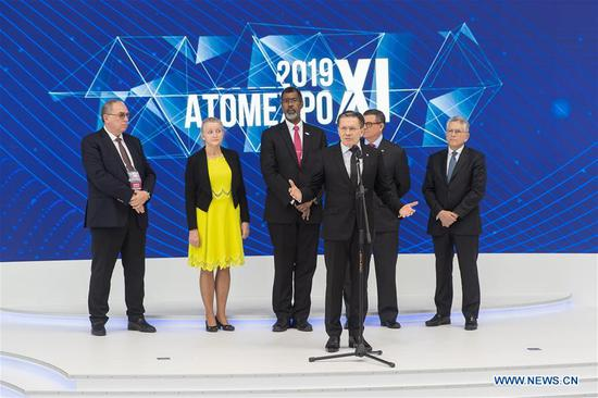 Alexey Likhachev (Front), general director of Russia's Rosatom State Corporation, addresses the opening ceremony of the 11th ATOMEXPO in Sochi, Russia, on April 15, 2019. Global experts called for the further development of nuclear technology and cooperation so as to cope with climate change and realize sustainable development at the 11th ATOMEXPO International Forum here on Monday. (Xinhua/Bai Xueqi)
