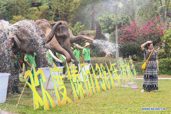 People celebrate the water-sprinkling festival at the Wild Elephant Valley scenic spot in Dai Autonomous Prefecture of Xishuangbanna, southwest China's Yunnan Province, April 14, 2019. People sprinkle water to each other to pray for good fortune during the traditional water-sprinkling festival, which is also the New Year festival of the Dai ethnic group. (Xinhua/Qin Qing)