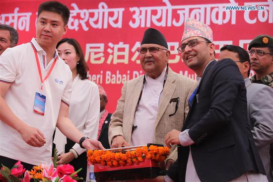 """Nepalese Prime Minister KP Sharma Oli (C) attends the ceremony celebrating the breakthrough of the 12.2 km tunnel of Bheri Babai Diversion Multipurpose Project (BBDMP) in Surkhet district of Karnali Province in western Nepal, on April 16, 2019. Celebrating the breakthrough of a national project constructed by China, Nepali leaders and officials said here Tuesday that the project has supported the country's determination to realize its national dream """"Prosperous Nepal and Happy Nepali."""" As the first of its kind of inter-basin water transfer project, the main part of Bheri Babai Diversion Multipurpose Project (BBDMP) has been completed almost one year earlier than its original duration. (Xinhua/Zhou Shengping)"""