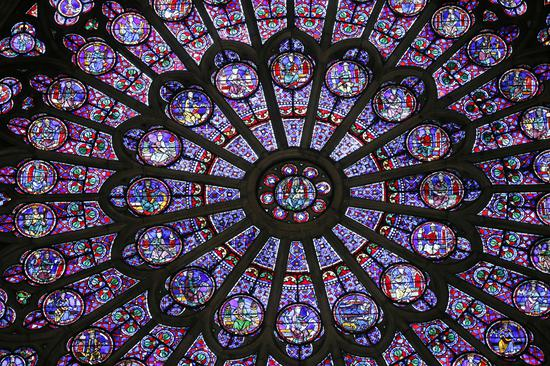 This photo taken on November 29, 2012 shows the stained glass rosace on the northern side of Notre Dame Cathedral in Paris that dates back to the Middle Ages. It survived the colossal fire that swept through the famed cathedral on April 15. The fire led to significant damage to the roof and interior of the building, and caused the collapse of a spire. [Photo: IC]