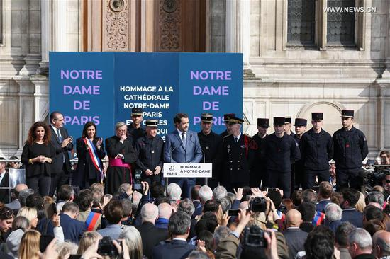 France's Interior Minister Christophe Castaner (C) addresses a commemoration ceremony for the cathedral of Notre Dame de Paris in front of the Hotel de Ville of Paris in Paris, France, April 18, 2019. A ceremony was held in front of Hotel de Ville of Paris on Thursday to commemorate the cathedral of Notre Dame de Paris which caught fire on Monday afternoon in Paris. (Xinhua/Gao Jing)