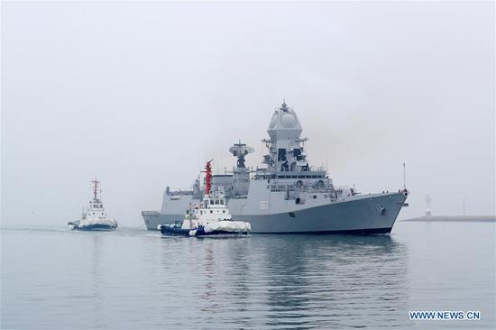 Indian navy's destroyer INS Kolkata arrives in the port city of Qingdao, east China's Shandong Province, April, 21, 2019, to join multinational naval events commemorating the 70th anniversary of the founding of the Chinese People's Liberation Army (PLA) Navy. The events will be held between April 22 and 25 and a naval parade will be held in Qingdao and nearby sea areas and airspace on April 23. (Xinhua/Ju Zhenhua)