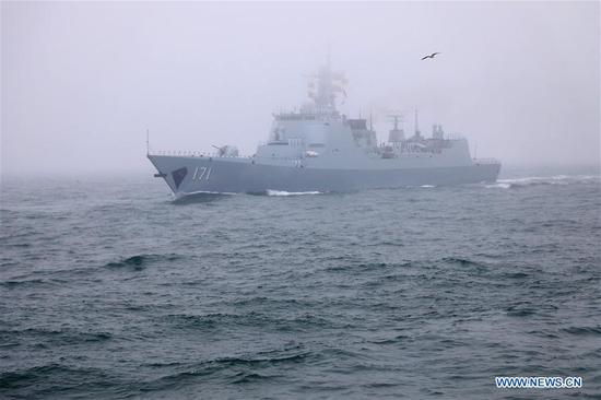 The guided-missile destroyer Haikou of the Chinese People's Liberation Army (PLA) Navy takes part in a naval parade staged to mark the 70th founding anniversary of the PLA Navy on the sea off Qingdao, east China's Shandong Province, on April 23, 2019. (Xinhua/Li Yun)