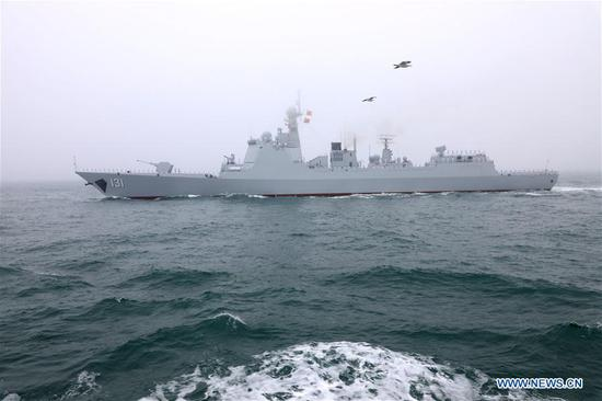 The guided-missile destroyer Taiyuan of the Chinese People's Liberation Army (PLA) Navy takes part in a naval parade staged to mark the 70th founding anniversary of the PLA Navy on the sea off Qingdao, east China's Shandong Province, on April 23, 2019. (Xinhua/Li Yun)