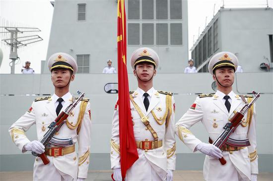 The honor guard of the Chinese People's Liberation Army (PLA) Navy stand in formation before a naval parade staged to mark the 70th founding anniversary of the PLA Navy at a pier in Qingdao, east China's Shandong Province, on April 23, 2019. (Xinhua/Li Gang)