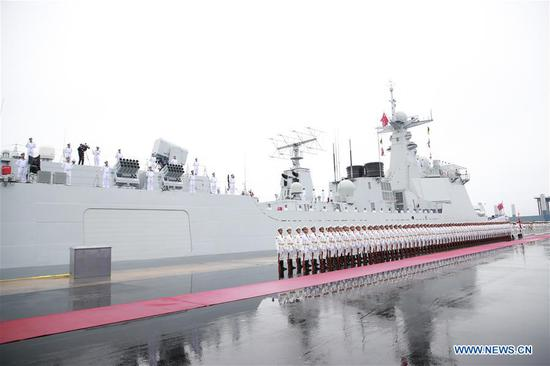The honor guards of the Chinese People's Liberation Army (PLA) Navy stand in formation before a naval parade staged to mark the 70th founding anniversary of the PLA Navy at a pier in Qingdao, east China's Shandong Province, on April 23, 2019. (Xinhua/Li Gang)