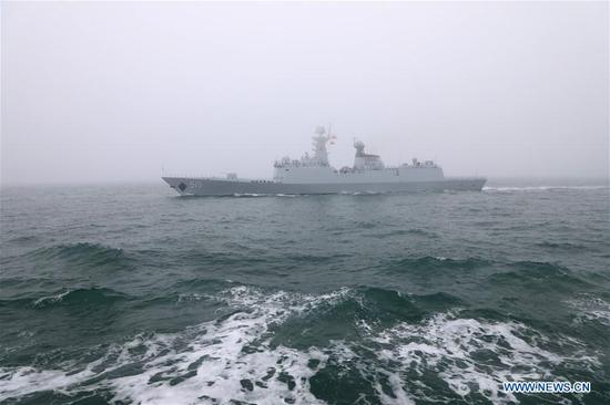 The missile frigate Binzhou of the Chinese People's Liberation Army (PLA) Navy takes part in a naval parade staged to mark the 70th founding anniversary of the PLA Navy on the sea off Qingdao, east China's Shandong Province, on April 23, 2019. (Xinhua/Li Yun)
