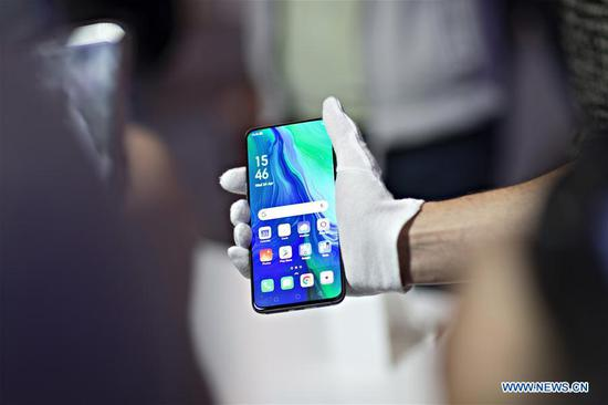 Photo taken on April 24, 2019 shows the Oppo Reno 5G smartphone at the launching ceremony in Zurich, Switzerland. Together with Switzerland's largest telecom company Swisscom, Chinese smartphone manufacturer Oppo launched its first 5G smartphone Reno 5G on Wednesday in Zurich. (Xinhua/Michele Limina)