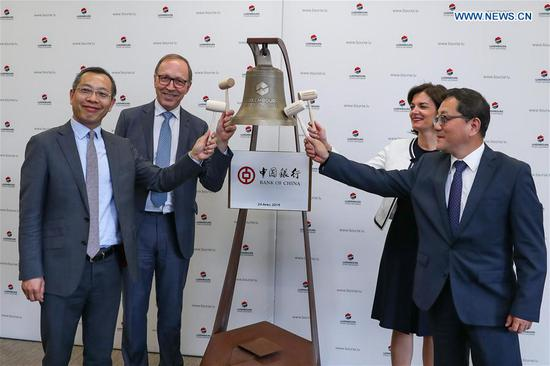 Guests take part in an official Bell Ceremony at the Luxembourg Stock Exchange in Luxembourg, April 24, 2019. The Bank of China has chosen Luxembourg to list its 500-million-U.S.-dollar bond during an official ceremony on Wednesday at the Luxembourg Stock Exchange. The U.S.-dollar-denominated bond is the first Belt and Road-themed bond to be listed on Luxembourg Stock Exchange after Luxembourg signed a memorandum of understanding with China to cooperate on the Belt and Road Initiative in late March. (Xinhua/Zhang Cheng)