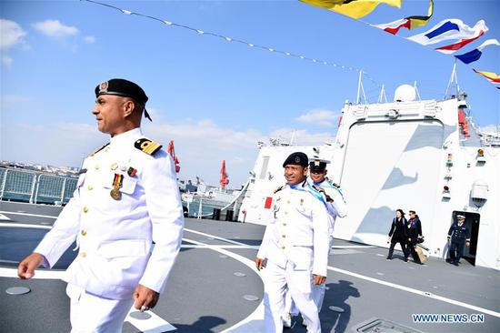 Foreign delegates visit the guided-missile destroyer Guiyang of the Chinese People's Liberation Army (PLA) Navy in Qingdao, east China's Shandong Province, April 25, 2019. Foreign delegations invited to participate in the multinational naval events marking the 70th anniversary of the founding of the Chinese PLA Navy visited Chinese vessels and communicated with Chinese soldiers and officers on Thursday. (Xinhua/Li Ziheng)