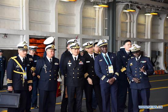 Foreign delegates visit the landing vessel Jinggangshan of the Chinese People's Liberation Army (PLA) Navy in Qingdao, east China's Shandong Province, April 25, 2019. Foreign delegations invited to participate in the multinational naval events marking the 70th anniversary of the founding of the Chinese PLA Navy visited Chinese vessels and communicated with Chinese soldiers and officers on Thursday. (Xinhua/Li Ziheng)