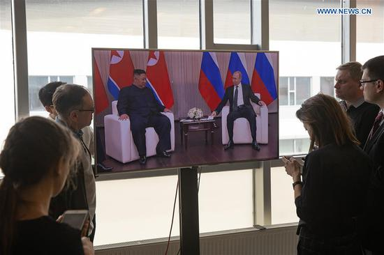 People watch a TV live broadcast on the meeting between Russian President Vladimir Putin and top leader of the Democratic People's Republic of Korea (DPRK) Kim Jong Un in Vladivostok, Russia, April 25, 2019. (Xinhua/Bai Xueqi)
