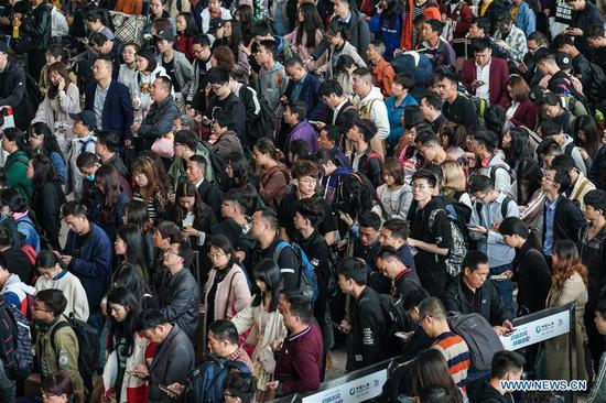 Passengers queue at the waiting room of Nanjing Railway Station in Nanjing, capital of east China's Jiangsu Province, April 30, 2019. Railway stations witness a travel rush as the May Day holiday is on hand. (Xinhua/Li Bo)