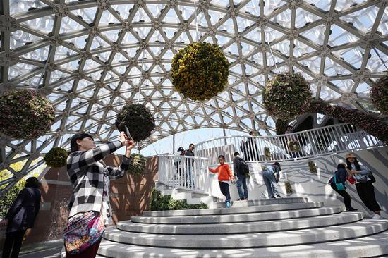 "Tourists visit the Shanghai Garden of the International Horticultural Exhibition 2019 Beijing in Yanqing District of Beijing, capital of China, May 1, 2019. Beijing International Horticultural Exhibition welcomed its first tourist peak by serving more than 320,000 tourists during the four-day May Day holiday, the organizer said Saturday. Some 132 activities, including float parades, world ethnic and folk cultural performances, and culture and art carnivals staged by central and eastern European countries, were held during the holiday. With the theme of ""Live Green, Live Better,"" the expo opened to the public on Monday at the foot of the Great Wall in the capital's Yanqing District and will last until Oct. 7. (Xinhua/Ju Huanzong)"