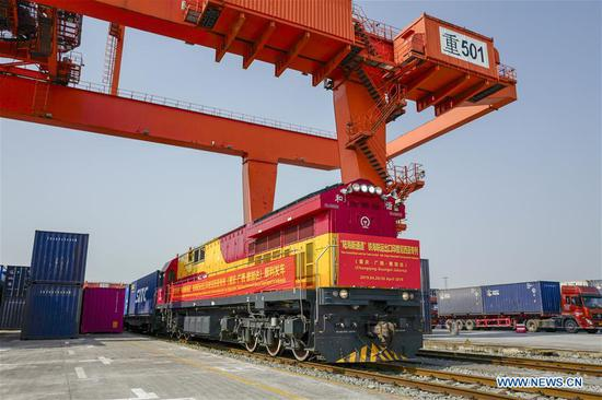 The land-sea freight train of the New International Land-Sea Trade Corridor heading for Indonesia waits to depart in southwest China's Chongqing, April 26, 2019. (Xinhua/Liu Chan)