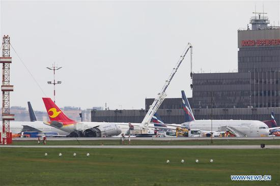 Burnt fuselage of an Aeroflot SSJ-100 passenger plane is seen on the tarmac at Sheremetyevo International Airport in Moscow, Russia, on May 6, 2019. Russia's Investigative Committee confirmed Monday that 41 people were killed after an SSJ-100 passenger plane en route to the northwestern Russian city of Murmansk caught fire before an emergency landing Sunday at the Sheremetyevo International Airport in Moscow. (Xinhua/Maxim Chernavsky)