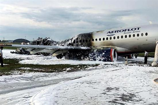 The Sukhoi Superjet 100 aircraft of Russian carrier Aeroflot is covered in fire retardant foam after an emergency landing in Sheremetyevo airport in Moscow on Sunday killed 41 people and injured several, some of them in critical condition. Despite the accident, Russia said it sees no reason to ground its domestically produced jets, the country's transport minister said yesterday. The Sukhoi Superjets are the first new passenger jet built in Russia since the dissolution of the Soviet Union.