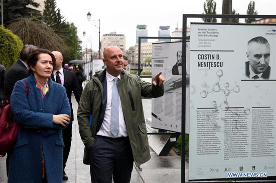 "People visit the exhibition ""Romanian inventors and their contribution to the world heritage"" in Sarajevo, capital of Bosnia and Herzegovina (BiH), on May 6, 2019. An exhibition, which focuses on Romanian inventors' contribution to world heritage, was unveiled on Monday in Bosnia and Herzegovina's capital of Sarajevo. (Xinhua/Nedim Grabovica)"