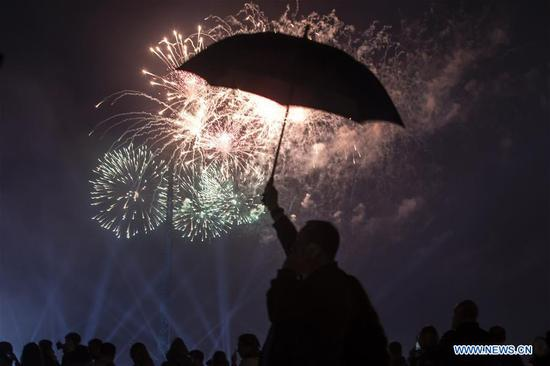 People watch fireworks during the Victory Day celebrations in Moscow, Russia, on May 9, 2019. Russia marks the 74th anniversary of the victory over Nazi Germany in World War II on Thursday. (Xinhua/Alexander Zemlianichenko Jr)