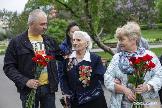 World War II veteran Galina Malysheva (C), 95, talks with others during celebrations of the Victory Day in Moscow, Russia, on May 9, 2019. Russia marks the 74th anniversary of the victory over Nazi Germany in World War II here on May 9. (Xinhua/Alexander Zemlianichenko Jr)