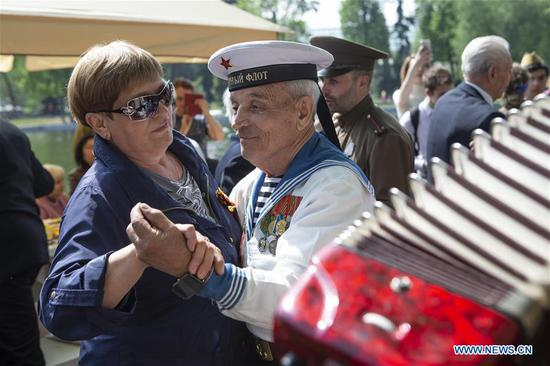 World War II veteran Victor Novopashin (R), 87, dances during celebrations of the Victory Day in Moscow, Russia, on May 9, 2019. Russia marks the 74th anniversary of the victory over Nazi Germany in World War II here on May 9. (Xinhua/Alexander Zemlianichenko Jr)