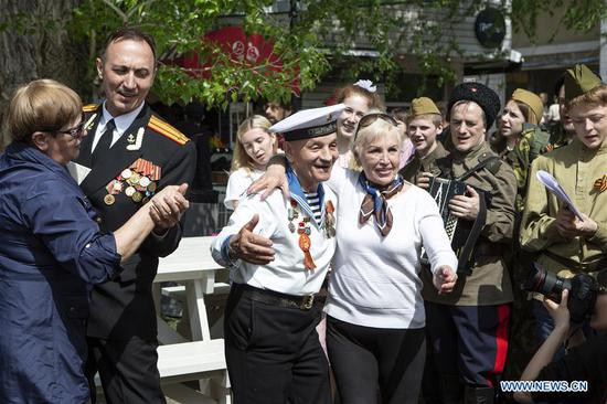 WWII veteran Victor Novopashin (L in center), 87, dances during celebrations of the Victory Day in Moscow, Russia, on May 9, 2019. Russia marks the 74th anniversary of the victory over Nazi Germany in World War II here on May 9. (Xinhua/Alexander Zemlianichenko Jr)