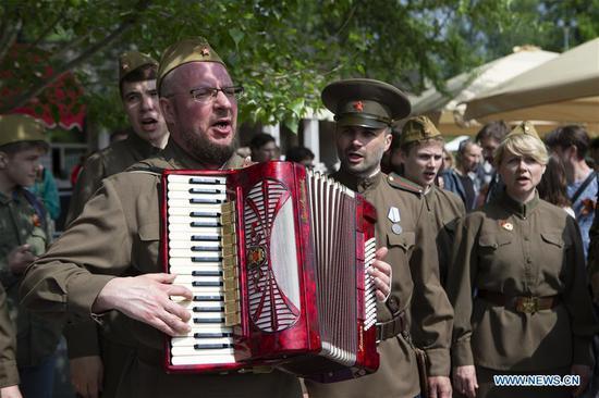 People dressed in Soviet-era uniforms attend celebrations of the Victory Day in Moscow, Russia, on May 9, 2019. Russia marks the 74th anniversary of the victory over Nazi Germany in World War II here on May 9. (Xinhua/Alexander Zemlianichenko Jr)