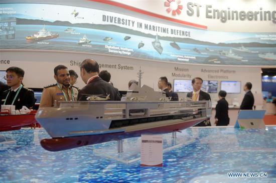 Visitors view exhibits at the 12th International Maritime Defense Exhibition and Conference (IMDEX Asia) in Singapore's Changi Exhibition Centre May 14, 2019. Singapore Defense Minister Ng Eng Hen welcomed here Tuesday foreign navies attending the 12th International Maritime Defense Exhibition and Conference (IMDEX Asia) at its opening ceremony. A total of 23 warships from 15 countries sailed their way to IMDEX Asia at the Changi Naval Base, together with 26 chiefs of defense forces and navies, vice chiefs, directors-general of coast guards and senior naval officers. (Xinhua/Then Chih Wey)