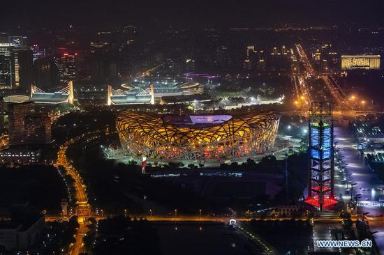 Photo taken on May 14, 2019 shows the night view of the National Stadium, also known as the Bird's Nest, in Beijing, capital of China. Roads and buildings were illuminated Tuesday evening before the upcoming Conference on Dialogue of Asian Civilizations (CDAC) in Beijing. (Xinhua/Shen Bohan)