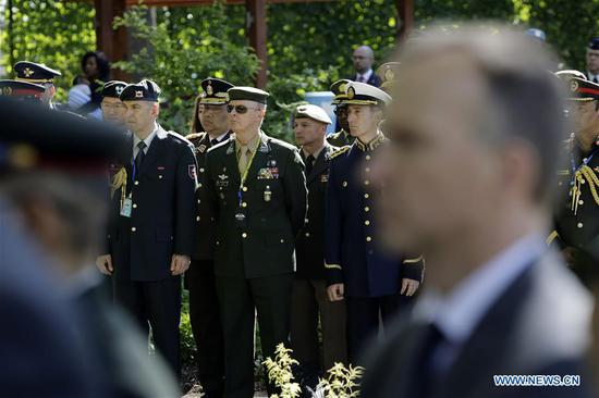 Peacekeeper representatives attend a solemn ceremony to commemorate their fallen colleagues at the UN headquarters in New York, May 24, 2019. The United Nations on Friday honored its fallen peacekeepers with a solemn ceremony on occasion of the International Day of UN Peacekeepers. (Xinhua/Li Muzi)