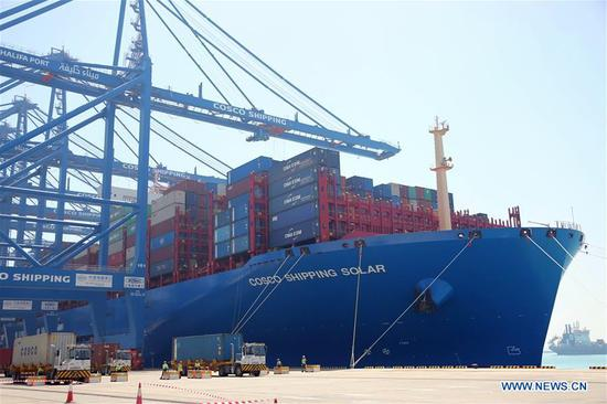 Chinese container ship SOLAR is seen at CSP Abu Dhabi Terminal of Khalifa Port in Abu Dhabi, the United Arab Emirates, on May 25, 2019. SOLAR, a Chinese container ship with a capacity of 21,000 TEU (twenty-foot equivalent unit), arrived on Saturday at the CSP Abu Dhabi Terminal of Khalifa Port in the United Arab Emirates (UAE). The CSP Abu Dhabi Terminal, built and operated by China's COSCO Shipping Ports Limited (CSP) and Abu Dhabi Ports, has a design capacity of 2.5 million TEU. (Xinhua/Su Xiaopo)