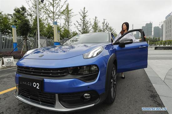 A visitor takes a test drive of the Lynk & Co 02 compact crossover at the Geely Research Institute in Hangzhou Bay in Ningbo, east China's Zhejiang Province, July 3, 2018. China has established the world's most comprehensive new energy vehicle (NEV) supporting system, Huang Libin, spokesman with the Ministry of Industry and Information Technology, said at a recent news conference. During the first quarter, China's NEV production and sales amounted to 304,000 and 299,000 vehicles respectively, up 102.7 percent and 109.7 percent. (Xinhua/Shen Bohan)