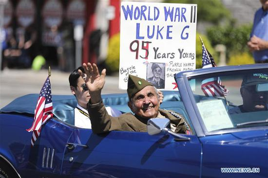 Luke Gasparre, a 95-year-old World War II veteran, takes part in the Memorial Day Parade in Queens of New York, the United States, May 27, 2019. The Memorial Day is a United States federal holiday observed on the last Monday of May. (Xinhua/Wang Ying)