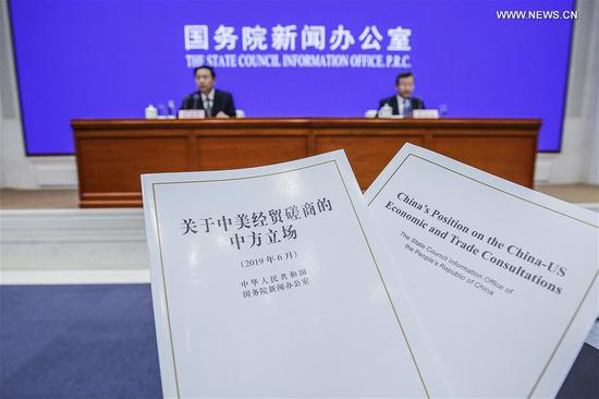 Photo taken on June 2, 2019 shows the newly-issued white paper at a press conference in Beijing, capital of China. The State Council Information Office on Sunday issued a white paper to provide a comprehensive picture of the China-US economic and trade consultations, and present China's policy position on these consultations. (Xinhua/Zhang Yuwei)