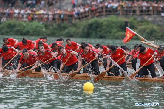 People take part in a dragon boat race to celebrate the Dragon Boat Festival on the Jinjiang River in Tongren City, southwest China's Guizhou Province, June 7, 2019. Various activities are held to celebrate the Dragon Boat Festival, or Duanwu, which falls on June 7 this year. (Xinhua/Wu Weidong)