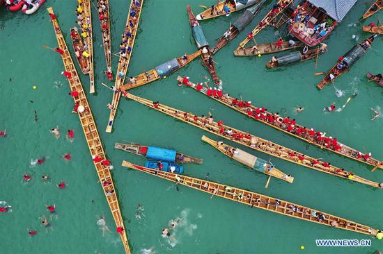 Aerial photo taken on June 7, 2019 shows people taking part in an activity to celebrate the Dragon Boat Festival on the Jinjiang River in Tongren City, southwest China's Guizhou Province. Various activities are held to celebrate the Dragon Boat Festival, or Duanwu, which falls on June 7 this year. (Xinhua/Wu Weidong)