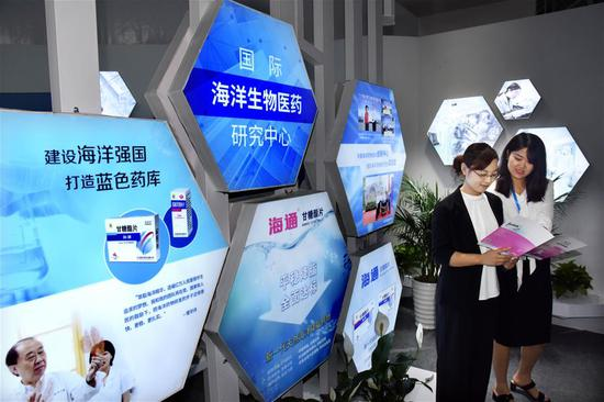 Visitors are seen during the Global Health Forum (GHF) of Boao Forum for Asia (BFA) at Qingdao World Expo City in Qingdao, east China's Shandong Province, on June 10, 2019. Themed with