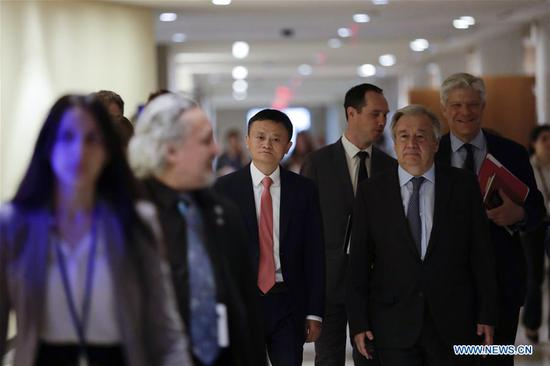Jack Ma (C) of China's Alibaba Group and United Nations Secretary-General Antonio Guterres (1st R, front) arrive to attend a high-level panel on digital cooperation at the UN Headquarters in New York, June 10, 2019. Jack Ma of China's Alibaba Group joined United Nations Secretary-General Antonio Guterres and Melinda Gates of the Gates Foundation in a live conversation here on Monday to discuss global digital cooperation for a safer and more sustainable future of the digital industry. (Xinhua/Li Muzi)