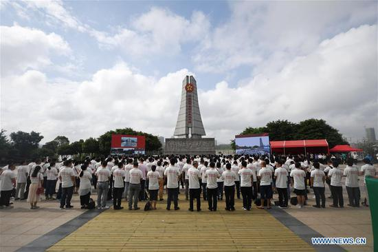 The launching ceremony of an activity that will take journalists to retrace the route of the Long March is held in Yudu County, east China's Jiangxi Province, June 11, 2019. The activity is aimed at paying tribute to the revolutionary martyrs and passing on the traditions of revolution, as the country celebrates the 70th anniversary of the founding of the People's Republic of China this year. Over 500 journalists from more than 30 media outlets across the country attended the ceremonies. The Long March was a military maneuver carried out by the Chinese Workers' and Peasants' Red Army from 1934 to 1936. During this period, they left their bases and marched through rivers, mountains and arid grassland to break the siege of Kuomintang forces and continue to fight Japanese aggressors. Many marched as far as 12,500 km. (Xinhua/Zhou Mi)