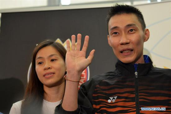 Malaysia's badminton player Lee Chong Wei (R) attends a news conference to announce his retirement in Putrajaya, Malaysia, June 13, 2019. (Xinhua/Chong Voon Chung)