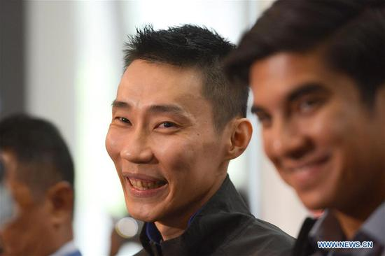 Malaysia's badminton player Lee Chong Wei (L) reacts during a news conference to announce his retirement in Putrajaya, Malaysia, June 13, 2019. (Xinhua/Chong Voon Chung)