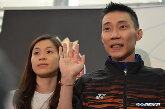 Malaysia's badminton player Lee Chong Wei (R) reacts during a news conference to announce his retirement in Putrajaya, Malaysia, June 13, 2019. (Xinhua/Chong Voon Chung)