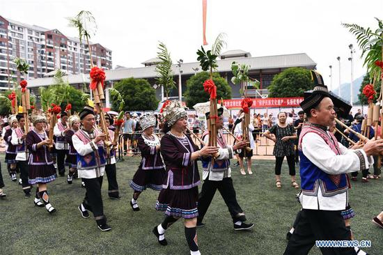 People celebrate the Longji Terrace Culture Festival in Longsheng County, south China's Guangxi Zhuang Autonomous Region, June 17, 2019. People of various ethnic groups gathered here to showcase their culture during the festival. (Xinhua/Wu Shengbin)