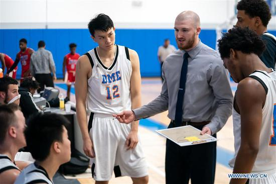 The photo taken in February 2019 shows Tony Sun (4th R) from China taking part in a post graduate basketball training program at DME Sports Academy (DMESA), in Daytona Beach of Florida, the United States. Sports skill training and culture exchange opportunities offered by DME Sports Academy for talented students and young individuals from around the world have advanced people-to-people connection between China and the United States. Established three years ago, DMESA offers top-level athletic development training and life skills mentoring to both U.S. domestic and overseas young talent. Some 60 to 75 kids are expected to join in DMESA next year, including about one tenth from China. (Xinhua/Zou Guangping)