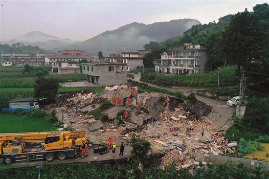 Rescuers search a building that collapsed in Shuanghe Town, Changning County on Tuesday after a 6.0-magnitude earthquake hit southwest China's Sichuan Province on Monday.