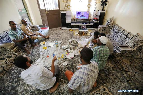 Residents watch television at home in Adama, Ethiopia, June 11, 2019. Steady power supply was acheived since a Chinese-built power distribution, rehabilitation and upgrading project involving 8 Ethiopian cities was put into operation in March 2019. (Xinhua/Wang Teng)