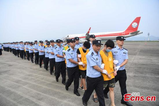 Calls for screening as 77 Chinese nationals deported from